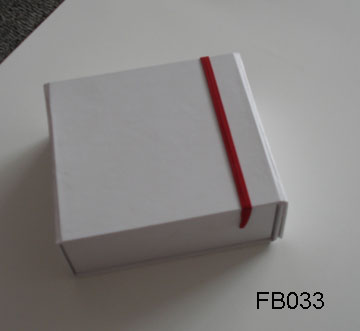 white folded box with elastic band